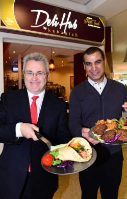 Birmingham Airport CEO Paul Kehoe (left) and Deli Hub Managing Director Sydd Sadiq salute the new opening | Image credit: The Moodie Report