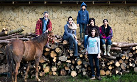 Organic halal farmers Lutfi Radwan and Ruby Radwan, with their children on Willowbrook Farm, Oxfordshire. Photograph: Harry Borden for the Observer Food Monthly